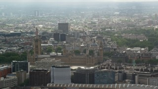 AX115_110 - 6K stock footage aerial video of Big Ben and Parliament against cityscape, London, England