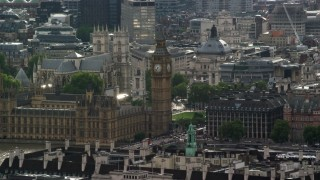 AX115_111 - 6K stock footage aerial video of Big Ben and Portcullis House among city buildings, London, England