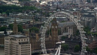 AX115_113 - 6K stock footage aerial video of Big Ben seen through the London Eye, England