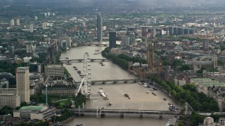 AX115_116 - 6K stock footage aerial video of Big Ben and London Eye, and bridges spanning River Thames, England