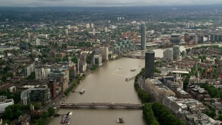 AX115_124 - 6K stock footage aerial video of Lambeth Bridge spanning the River Thames near MI6 Building in London, England