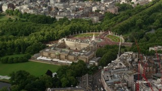 AX115_127 - 6K stock footage aerial video of an orbit of Buckingham Palace, London, England