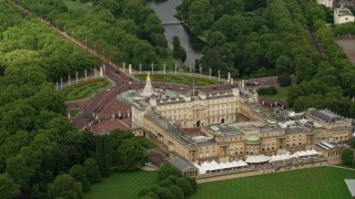 AX115_130 - 6K stock footage aerial video orbiting Buckingham Palace and Victoria Memorial, London, England