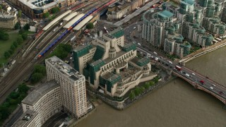 AX115_142 - 6K stock footage aerial video of tilting to the MI6 Building in London, England