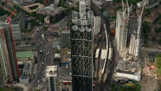 AX115_151 - 6K stock footage aerial video approach and fly over the Strata skyscraper, London, England