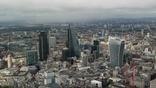 AX115_155 - 6K stock footage aerial video of skyscrapers among cityscape, Central London, England