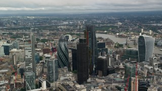 AX115_159 - 6K stock footage aerial video of orbiting skyscrapers in Central London, England