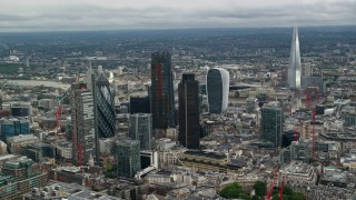AX115_160 - 6K stock footage aerial video of a view of skyscrapers and The Shard, Central London, England