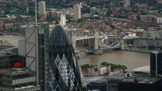 AX115_162 - 6K stock footage aerial video flyby The Gherkin to reveal Tower Bridge, Central London, England