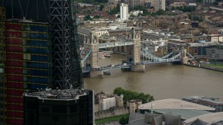AX115_164 - 6K stock footage aerial video flyby skyscraper to reveal Tower Bridge spanning River Thames, Central London, England
