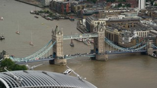 AX115_166 - 6K stock footage aerial video of a view of the Tower Bridge spanning River Thames, London, England