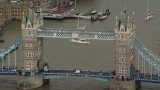 AX115_168 - 6K stock footage aerial video of a close orbit of the Tower Bridge on the River Thames, London, England
