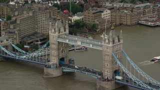 AX115_170 - 6K stock footage aerial video of the Tower Bridge with traffic, Central London, England