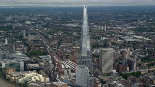 AX115_182 - 6K stock footage aerial video of an orbit of The Shard seen from the river in London, England