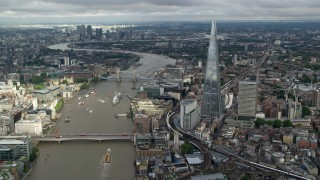 AX115_184 - 6K stock footage aerial video of The Shard, and Tower Bridge over the River Thames, London, England