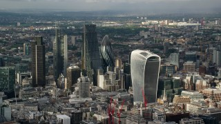 AX115_185 - 6K stock footage aerial video of orbiting skyscrapers in Central London, England