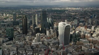 AX115_187 - 6K stock footage aerial video of approaching Central London skyscrapers, England