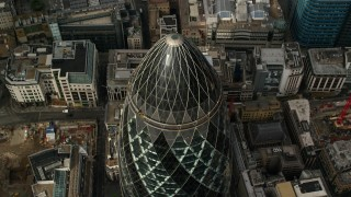 AX115_191 - 6K stock footage aerial video tilt to bird's eye view of The Gherkin skyscraper, Central London, England