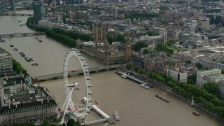 AX115_197 - 6K stock footage aerial video of London Eye, Westminster Bridge, Big Ben and Parliament by the Thames, England