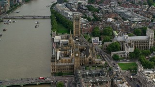 AX115_198 - 6K stock footage aerial video of Big Ben, Parliament and Westminster Abbey by the Thames, London, England