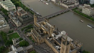 AX115_201 - 6K stock footage aerial video orbit above Big Ben and Parliament beside the River Thames, London, England