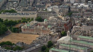 AX115_202 - 6K stock footage aerial video of orbiting Ministry of Defense, London England