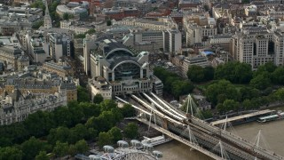 AX115_203 - 6K stock footage aerial video of orbiting London Charing Cross Railway Station, England