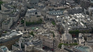 AX115_205 - 6K stock footage aerial video orbiting Trafalgar Square and Canada House, London, England