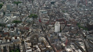 AX115_207 - 6K stock footage aerial video of city buildings surrounding Long Acre Charing Cross Road, London, England