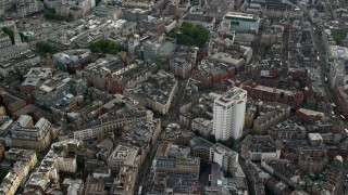 AX115_208 - 6K stock footage aerial video of orbiting city buildings around Long Acre and Charing Cross Road intersection, London, England
