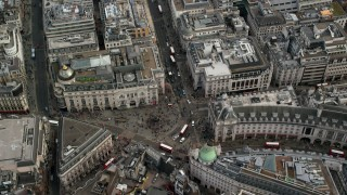 AX115_211 - 6K stock footage aerial video of a bird's eye view of traffic and tourists at Piccadilly Circus, London, England