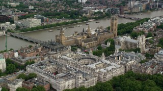 AX115_212 - 6K stock footage aerial video approach Big Ben, Parliament and government offices on the Thames, London, England