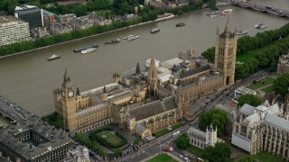 AX115_214 - 6K aerial stock footage video approach Big Ben and Parliament, London, England