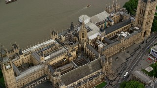 AX115_215 - 6K stock footage aerial video tilt to bird's eye view of the British Parliament, London, England