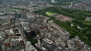 AX115_217 - 6K stock footage aerial video flyby office buildings toward Buckingham Palace, London, England