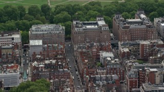 AX115_219 - 6K stock footage aerial video of office and apartment buildings and city streets, London, England
