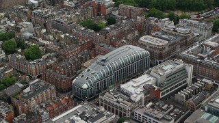 AX115_222 - 6K stock footage aerial video of orbiting Park House mall, London, England