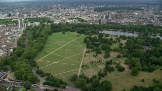 AX115_224 - 6K stock footage aerial video of Hyde Park and The Serpentine, London, England