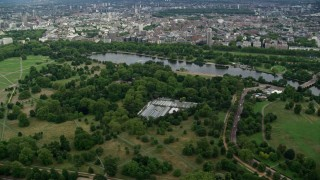 AX115_225 - 6K stock footage aerial video flyby Hyde Park and The Serpentine, London, England