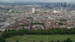AX115_227 - 6K stock footage aerial video of a view of the London cityscape from Hyde Park, England