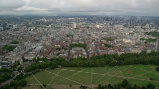 AX115_228 - 6K stock footage aerial video of London cityscape and approach nearby office buildings, England