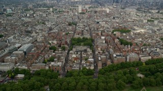 AX115_229 - 6K stock footage aerial video approach United States Embassy among office buildings, London, England