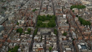 AX115_230 - 6K stock footage aerial video approach United States Embassy, London, England