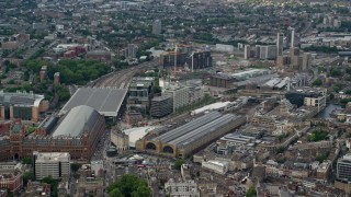 AX115_236 - 6K stock footage aerial video of Kings Cross Station and office buildings, London, England