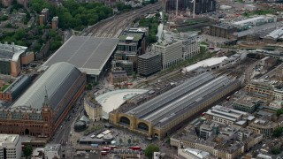 AX115_237 - 6K stock footage aerial video approach the Kings Cross Train Station, London, England
