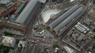 AX115_238 - 6K stock footage aerial video of tilting to bird's eye of Kings Cross Train Station, London, England