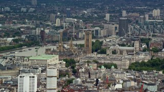 AX115_239 - 6K stock footage aerial video of Big Ben and Parliament among city buildings, London, England