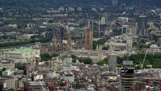 AX115_241 - 6K stock footage aerial video of Big Ben, Parliament and city buildings in London, England