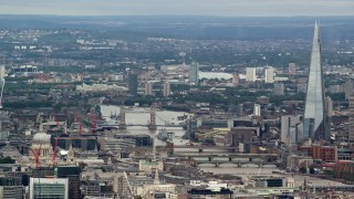 AX115_243 - 6K stock footage aerial video of Tower Bridge over the Thames, The Shard and cityscape, London, England