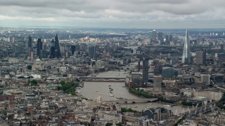 AX115_250 - 6K stock footage aerial video of a wide view of the cityscape, from Central London to Shard by River Thames, England